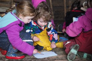 Beach Babies Pre-schoolers painting with watercolours at Landbeach Tithe Barn
