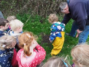 Beach Babies' Pre-schoolers at the Tithe Barn, helping Alan Shipp, Tithe Barn Trustee, sow wheat seed
